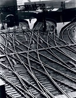 Photograph by Cyril Herbert, showing a graphic high level view of railway tracks