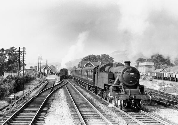 British Railways-built Fairburn 2-6-4 tank steam locomotive No 42015 leaving Settle station with a southbound local passenger train, c.1959. Photograph by Eric Treacy