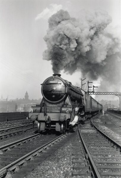 Flying Scotsman' A3 Class steam locomotive leaving Leeds station, Yorksire, with the 'White Rose' express for King's Cross station, London
