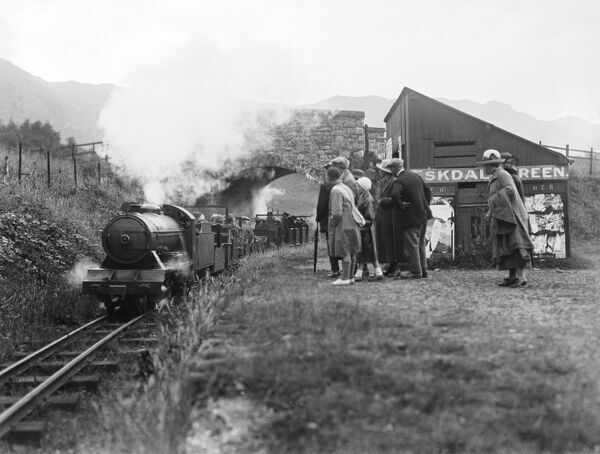 Passengers waiting for a train, at Eskdale Green station on the Ravenglass & Eskdale Railway, by HGW Household, about 1927