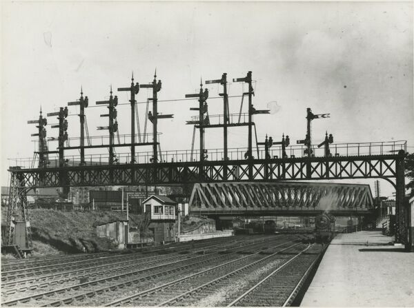 York, Holgate Bridge, London and North Eastern Railway. 1937. At Holgate bridge, a signal gantry stands high above the tracks on the approach into York station