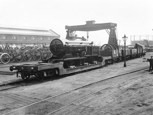 Locomotive being carried on wagons, 1914