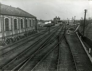Mildenhall, view into terminal station, goods shed, with border of roses on the left