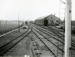 Mildenhall, view west from the station towards goods shed. At right is a signal post