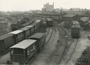Passenger station is in background, Foster's mill is behind. The storage sidings