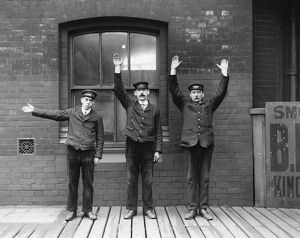 Staff of the Lancashire and Yorkshire Railway demonstrating hand signals. Photograph