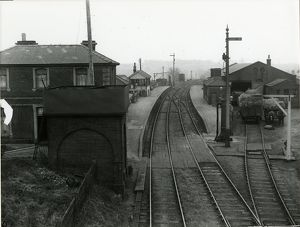 View looking east towards Braintree at Dunmow Station about 1911. Water tank in foreground
