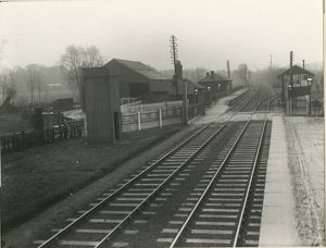 View looking west at Burnt Mill station showing the level crossing and signal box